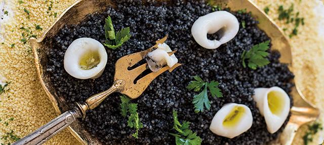 Chipirón plancha con couscous de tinta